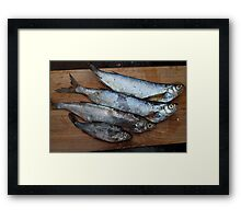 raw fish on a cutting table Framed Print