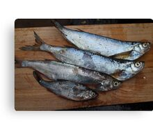 raw fish on a cutting table Canvas Print