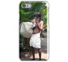 A worker carries a bg of laundry in Cochin India iPhone Case/Skin