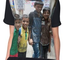 Four boys happily pose for a photo in Cochin India Chiffon Top