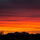 Sunset over The Olgas  by Doug Cliff