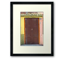 Brown Door in a Painted Wall Framed Print