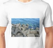 Rocks that break the waves and blue sea. Unisex T-Shirt