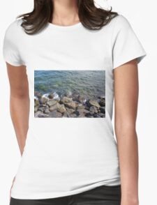 Rocks that break the waves and blue sea. Womens Fitted T-Shirt