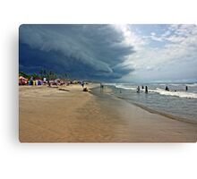 Storm clouds of an tropical hurricane bringing heavy rain over West Africa. Seen on a beach. Canvas Print