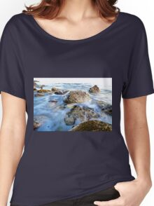 Rocks in a blue ocean waves.  Women's Relaxed Fit T-Shirt