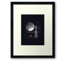 Taking the moon Framed Print