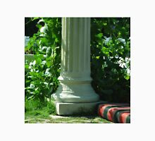 White classical column in the garden with green leaves. Unisex T-Shirt
