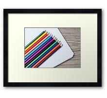 colored pencils and album closeup  Framed Print