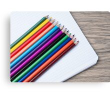 colored pencils and album closeup  Canvas Print