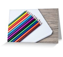 colored pencils and album closeup  Greeting Card