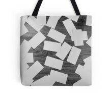 white sheets of paper scattered  Tote Bag
