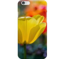 A yellow tulip flower set against a colourful background iPhone Case/Skin