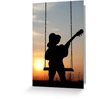 Toddler playng guitar during sunset - Silhouette Greeting Card