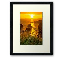 beautiful sunset over the coastal rocks Framed Print