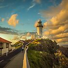 They gather to watch the Sunset at Byron Bay Lighthouse by Clare Colins