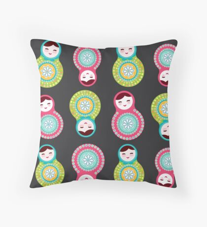 Pink and green matryoshka on black background Throw Pillow
