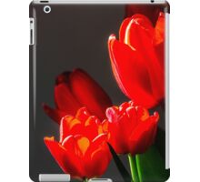 Red tulips on black background iPad Case/Skin