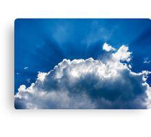 sun's rays behind the cloud Canvas Print