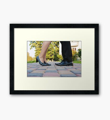legs of man and woman on a romantic meeting Framed Print