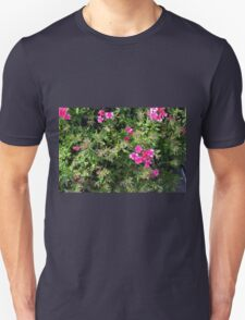 Pink purple flowers in the bush in the park. Unisex T-Shirt