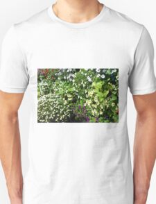 Colorful, many small flowers in the garden. Unisex T-Shirt