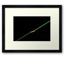 Green laser in dark glass Framed Print