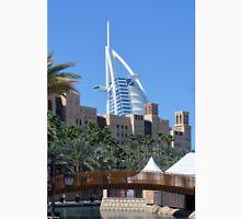 Photography of Arabic buildings and wooden bridge in front of Burj al Arab hotel from Dubai, United Arab Emirates. Unisex T-Shirt