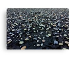 Black sand and colored stones beach Canvas Print