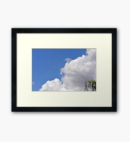 Blue sky with white clouds and soap bubbles. Framed Print