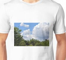 Trees tops with green leaves in the park with blue sky and white fluffy clouds. Unisex T-Shirt