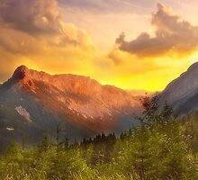 Orange Sunset in the alps by Delfino