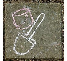 Kids' drawing on a paving stone: bucket and spade Photographic Print