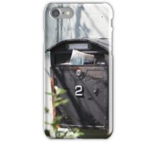 Old mailbox with newspaper iPhone Case/Skin