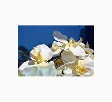 White plastic flowers. Unisex T-Shirt