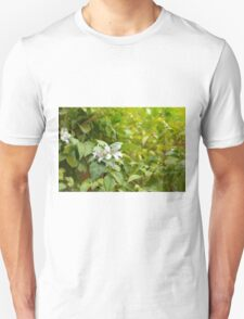 Sunny image with green leaves and small white flower. T-Shirt