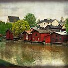 Red Buildings Along the River by Lucinda Walter