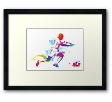 Colorful footballer chasing the ball graphics Framed Print