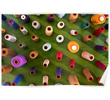 Multicolor sewing threads on wooden background Poster