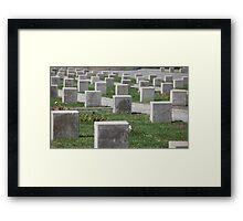 tombstones unknown soldiers at the military cemetery Framed Print