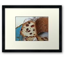 Cupcake with raisins close to Framed Print