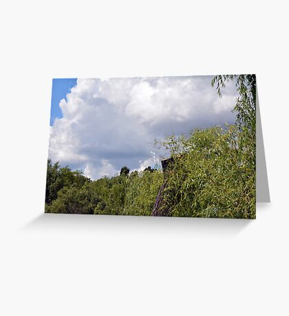 Park scenery with trees tops and cloudy sky with soap bubbles. Greeting Card