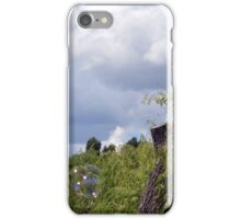Park scenery with trees tops and cloudy sky with soap bubbles. iPhone Case/Skin