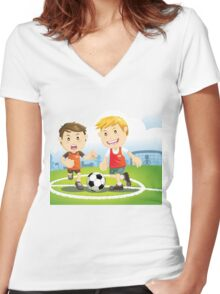 Two boys play soccer on a field Women's Fitted V-Neck T-Shirt