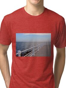 The sea and promenade with  white handrail. Tri-blend T-Shirt