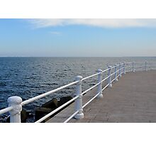 The sea and promenade with  white handrail. Photographic Print