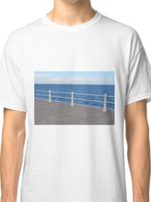 The sea and promenade with  white handrail. Classic T-Shirt