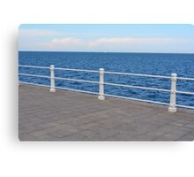 The sea and promenade with  white handrail. Canvas Print