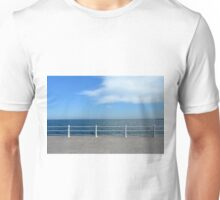 The sea and promenade with  white handrail. Unisex T-Shirt
