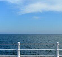 The sea and promenade with  white handrail. Sticker